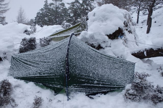 Tent with Tarp on Top During the Winter